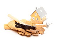 Hammer, Gloves, Nails and House Isolated on a White Background.