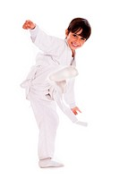 Karate kid kicking over isolated white background