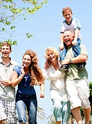Happy family having fun in the park with three children