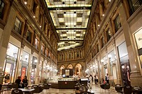Galleria Alberto Sordi Shopping Gallery illuminated at night in Rome, Italy, Europe