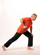Older man fortifying his triceps with barbells _ mobilization through easy exercises