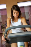 young woman at an ergometer