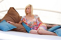 beautiful young woman relaxing in garden lounge