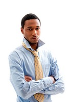 Handsome African American male in blue shirt and yellow tie with arms crossed and collar up, isolated