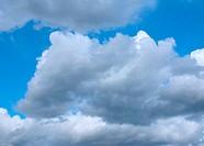 blue sky with rain clouds