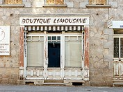 An old storefront with a sign above which reads ´Boutique Limousine´, Peyrat-le-Château, Limousin, France