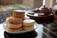 a close_up view of mooncakes and teaware