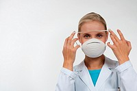 Young female doctor wearing a protecting mask