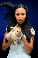 beautiful asian woman with rabbit