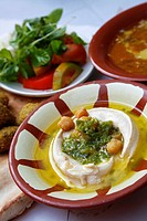 Hummus, Falafel and bubbling beans at the famous Hashem Restaurant in downtown Amman, Jordan
