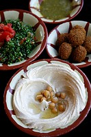 Typical breakfast of hummus, falafel salad and pita bread, Aqaba, Jordan