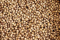 Roasted chickpeas on a counter in an open marketplace