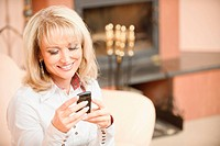 Woman reading sms on phone