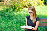 young fair_haired woman reading book