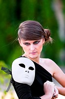 Caucasian girl with white mask on shoulder