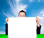 Surprised businessman with blank board