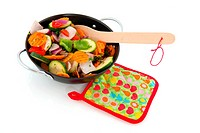 cut vegetables in a frying pan