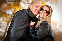 Attractive Couple in Park with Leather Jackets