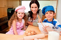 Mother and her children preparing cookies together