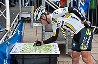 Scotland, Scottish Borders, Peebles. Mark Cavendish of Team HTC Highroad adds his signature to a stage one route map at the start of stage one of the ...