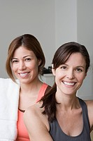 Portrait of two smiling women in gym