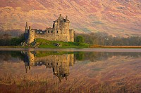 Scotland, Argyll and Bute, Loch Awe. Ruins of the 15th century Kilchurn Castle reflected in Loch Awe
