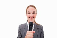 Smiling woman with microphone against a white background