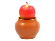 Fresh red apple in a clay pot.