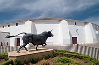 a statue of a bull in front of the bullfighting arena, Plaza de Toros in Ronda is the oldest bullfighting arena in Spain, Ronda, Malaga province, Anda...
