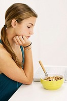 Teenage girl refusing to eat her cereals suffering from anorexia