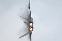 Modern and stealth american jet fighter F-22A Raptor turning  Note nozzles incorporate thrust vectoring new technology  Elmendorf air foece base, Anch...