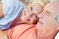 Portrait of smiling senior couple cuddling