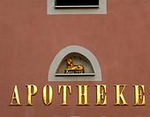 Lion sculpture above a gilded script Apotheke