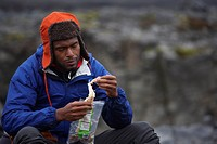 Man eating dried fish during hike