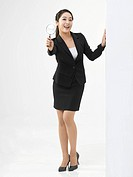 Portrait of Business woman holding magnifying glass