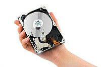 Hand and computer hard drive