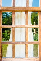 Old wooden windows with drape
