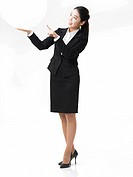 Full_length View of Business woman standing against white background, portrait