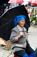 An old Miao woman in a colorful market in south Yunnan,China