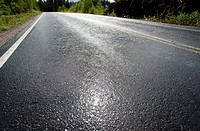 Wet tarmac surface after rain. Location Harunvuori Vesanto Finland Scandinavia Europe EU.