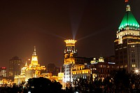 The buildings of the Bund at night. Peace Hotel in foreground, Shanghai, China