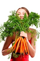 attractive woman holds bunch of carrots