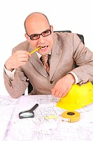 Businessman thinking with architectural plans