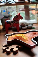 CAKE IN THE SHAPE OF A HORSE IN A COLORFUL METAL MOLD, HOME_MADE PASTRIES
