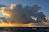 Heavy clouds on sea horizon at sunrise, Kauai Island, Hawaii Islands, USA