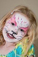 young girl wearing face paint on holiday,caribbean