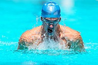 Young Man Swimming Breaststroke