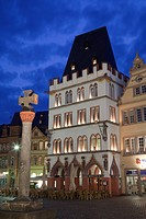 Market cross and restaurant illuminated at night, Steipe, Trier, Rhineland_Palatinate, Germany, may
