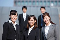 Young Businesswomen and Businessmen Smiling
