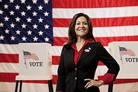 Caucasian businesswoman standing in polling place